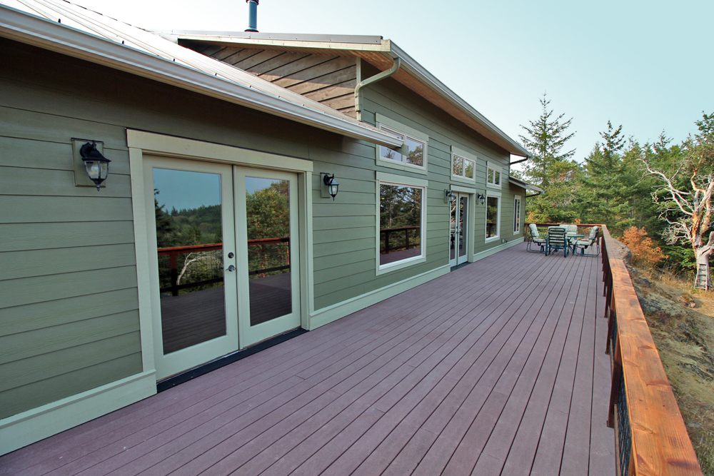 Deck and exterior view of custom craftsman home built in San Juan Island.
