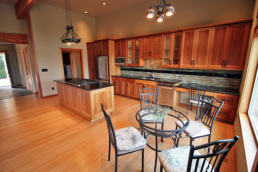 The kitchen and dining room for the custom craftsman home built in San Juan Island.