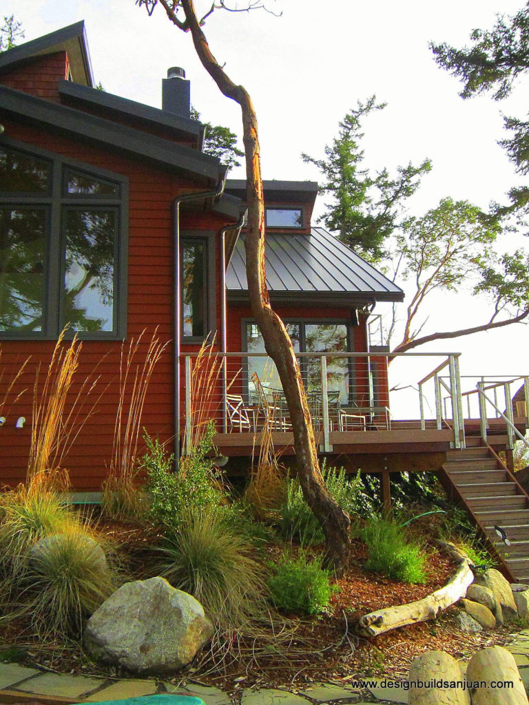 Exterior of the completed custom waterfront home build project in San Juan Islands.
