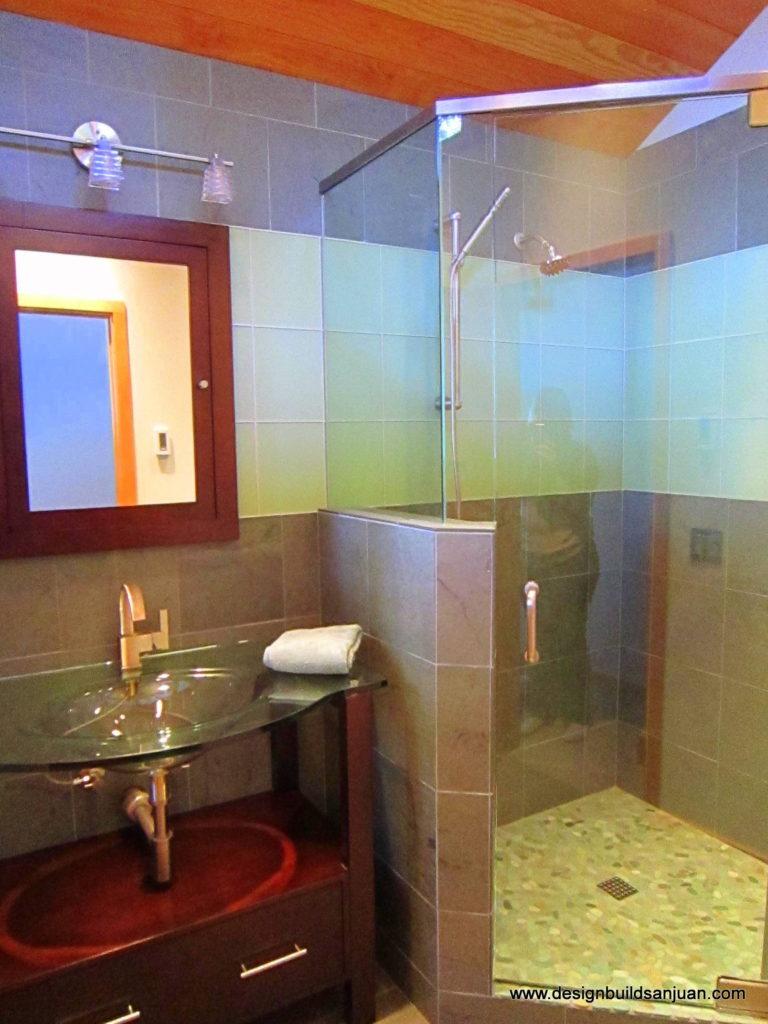 Bathroom featuring a glass sink and shower in San Juan Island., WA.