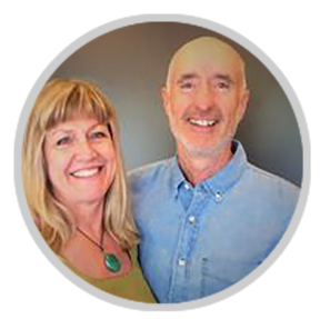 Design Build San Juan owners Terry Whalen and Lori Whalen standing closely side-by-side