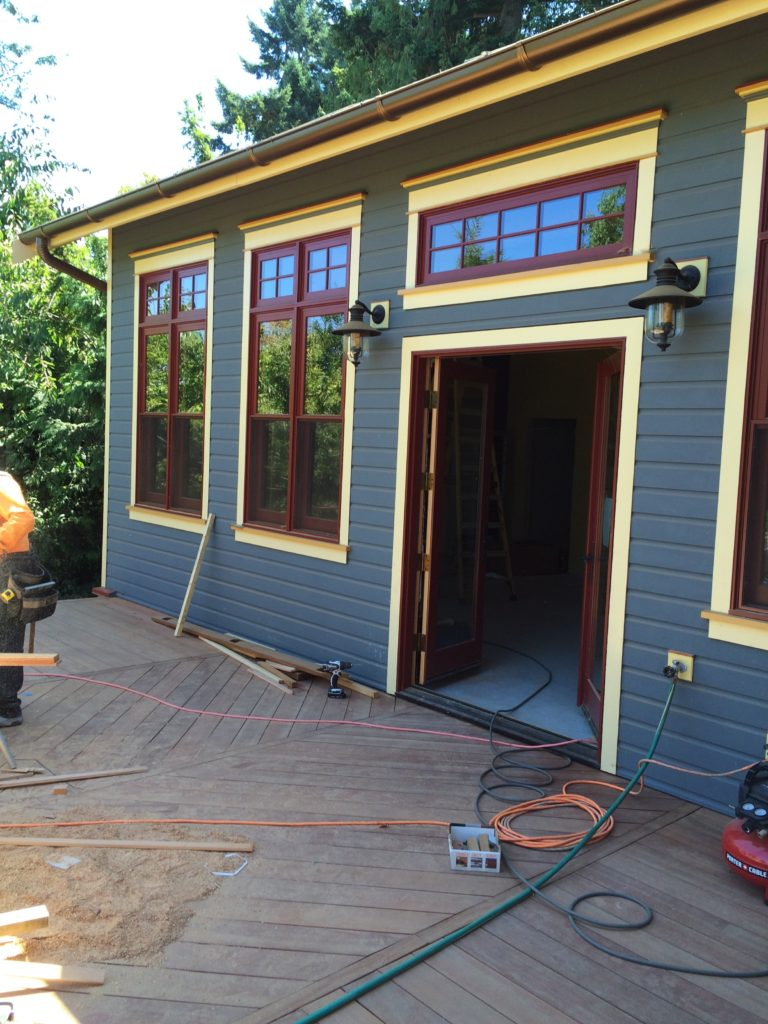 Exterior shot featuring new paint and windows for the 100-Year-Old home remodel project in Friday Harbor, WA.