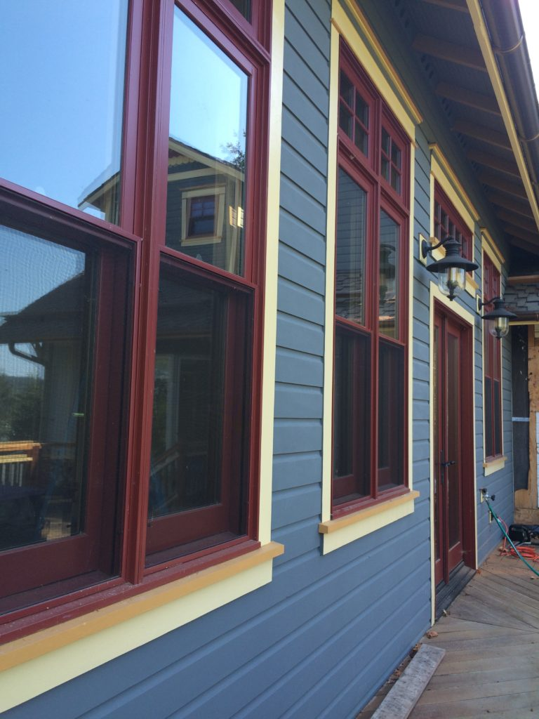 Alternate outside view of a home renovation project in Friday Harbor, WA. Focuses is on brand new paint job and windows.